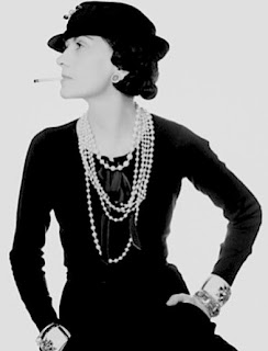 coco-chanel-wearing-maltese-cross-cuff-photo-by-man-ray-1935